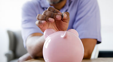 Man and piggy bank image