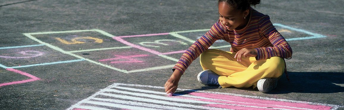 child drawing with chalk