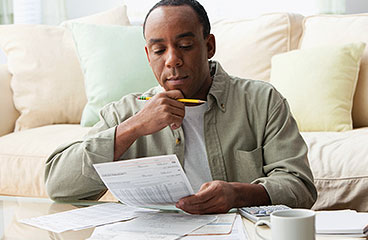 A man looking over his benefits information.