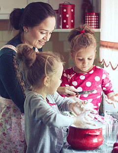 Mother baking with two young girls