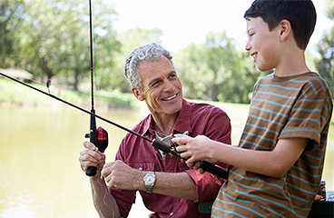 Grandfather fishing with his grandson