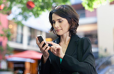 Woman tapping on her phone
