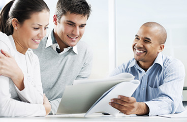 Couple looking at paperwork with their advisor