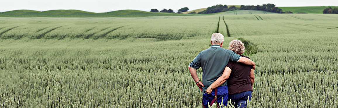 Middle-aged couple standing in a field