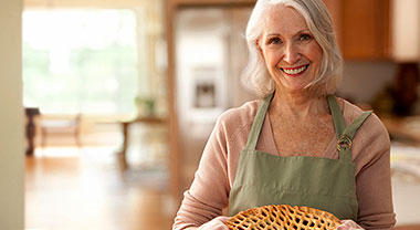 Older woman with a freshly made pie