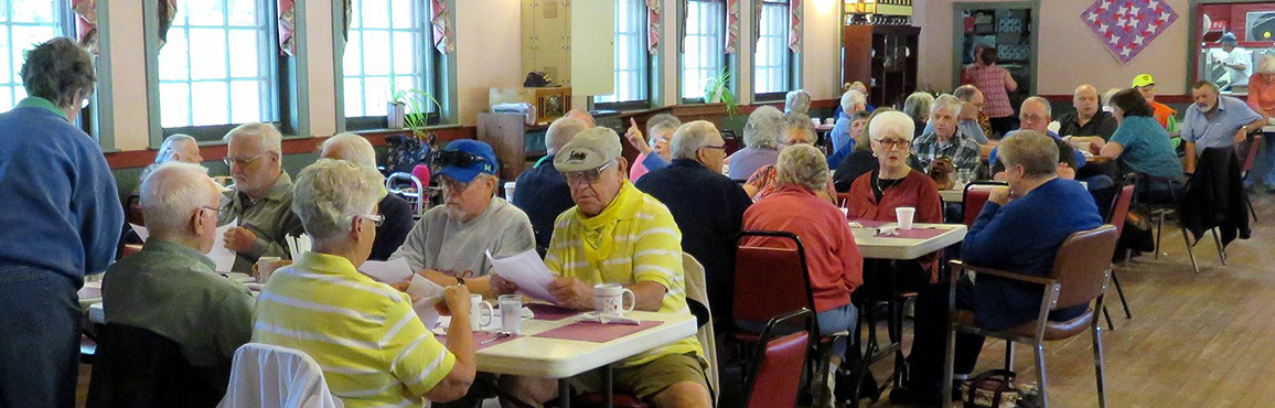 Elderly folks enjoying a meal together in their retirement community