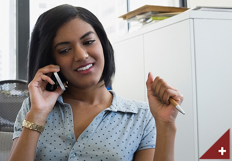 Young woman on the phone in an office