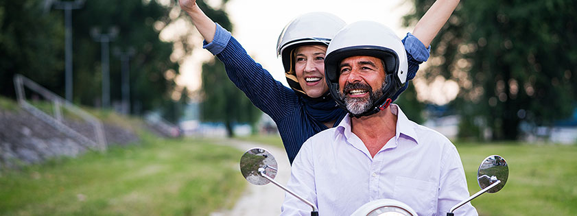 Couple riding a motorcyle