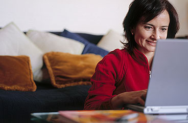 Woman thoughtfully sitting at her computer