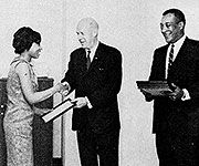 women accepting award