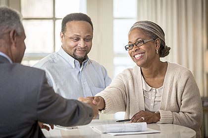 Couple speaking to an advisor