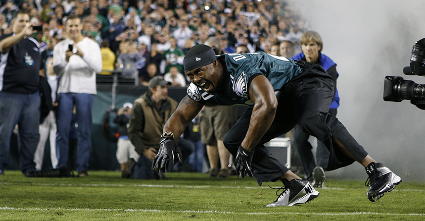 Brian Dawkins in uniform running out onto the Lincoln Financial Field